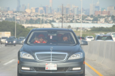 Acharya Swamishree�s car makes its way down the New Jersey Turnpike with the New York City skyline in the background
