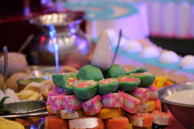 Colorful display of sweets in the annakut