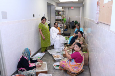 Disciples prepare mahaprasad for the New Year's Celebration