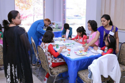 Young open house guests perform arts and crafts