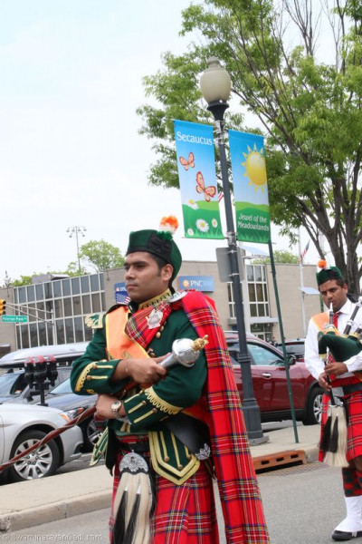 Swamibapa Pipe Band Drum Major leads the band throughout the town of Secaucus