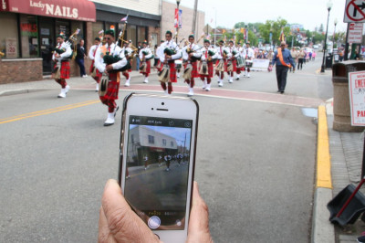 Thousands of onlookers took numerous pictures of Swamibapa Pipe Band throughout the parade