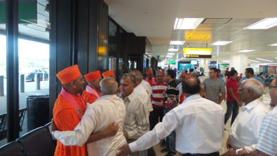 Disciples greet sants shortly after they land at Newark Liberty International Airport