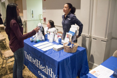 Temple volunteer coordinates with the various healthcare organizations present