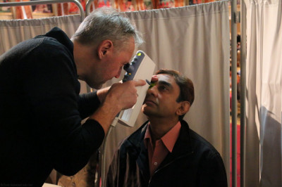 A doctor examines a patient's eyes