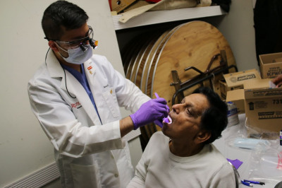 A dentist completes a patient's dental examination