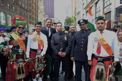 Shree Muktajeevan Swamibapa Pipe Band USA members pose for a picture with Indian police officers in the New York City Police Department