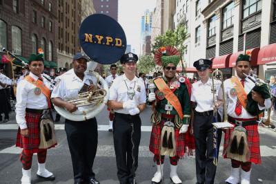 Shree Muktajeevan Swamibapa Pipe Band USA members pose for a picture with members from the NYPD marching band