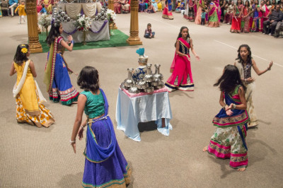Young disciples perform a dance at the Sharad Purnima celebrations