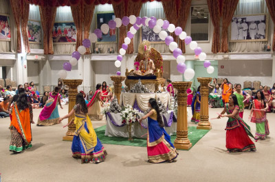 Disciples perform a dance for Sharad Purnima celebrations