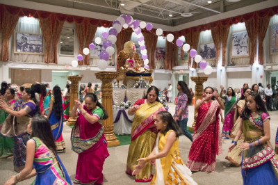 Disciples perform samuh-raas at the Sharad Purnima celebration
