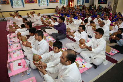 Disciples partake in the Maha-Yagna