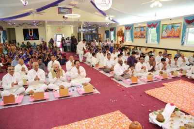 Disciples perform aarti at the conclusion of the Maha-Yagna