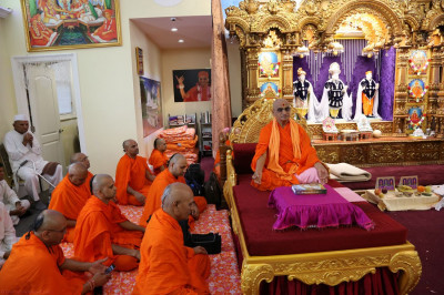 Acharya Swamishree and sants sit in meditation for a half-hour, in commemoration of Sadguru Din