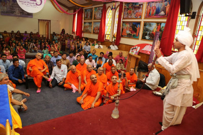 A young disciple performs in a religious skit to please Lord Swaminarayanbapa Swamibapa and Acharya Swamishree