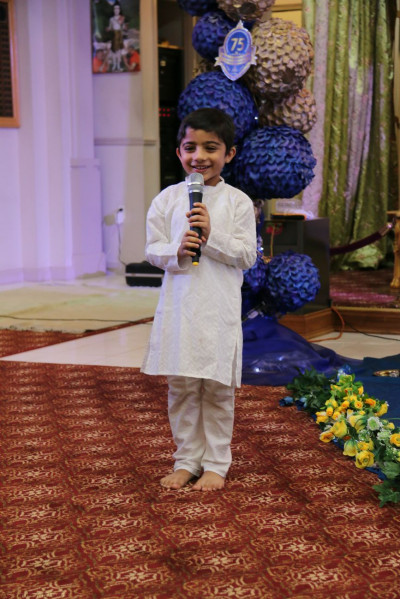A young disciple delivers a speech about Acharya Swamishree