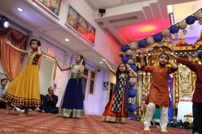 Young disciples perform a dance as part of the Sadbhav Amrut Parva celebrations