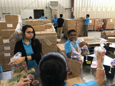 Volunteers pack 2017 children's meals at the Food Bank of Delaware under the #EndHunger campaign