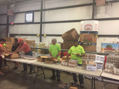 Volunteers prepared 432 natural disaster relief packages at the Dare to Care Food Bank in Fern Creek, Kentucky