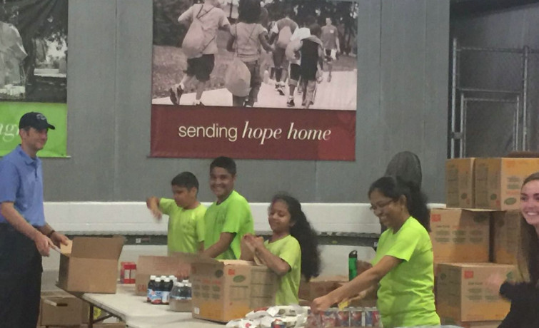 Louisville, Kentucky Mandal volunteers at the Dare to Care Food Bank