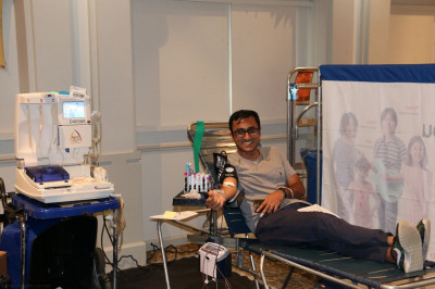 A disciple and member of the local community donates blood