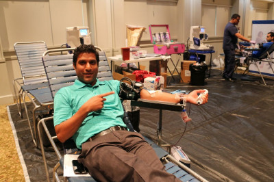 A member of the local community and Shree Swaminarayan Mandir New Jersey eagerly donates blood