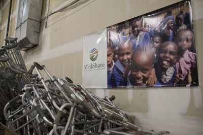 Volunteers are responsible for cleaning, sorting, and packaging the crutches and walkers shown as they will soon help less fortunate people like the children depicted in the poster