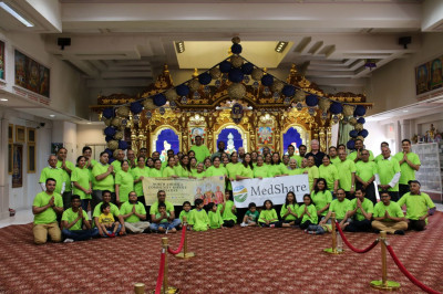 Volunteers pose for a photo with Medshare's amazing staff inside the Shree Swaminarayan Temple