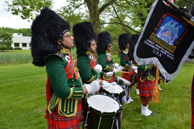 Shree Muktajeevan Swamibapa Pipe Band USA drumcore is pictured playing to the tune of the pipes