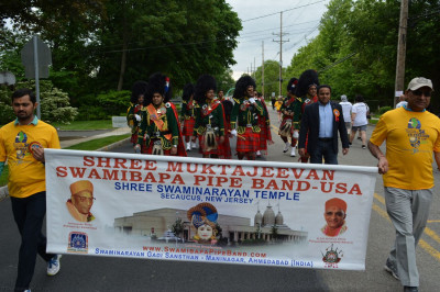 Shree Swaminarayan Temple volunteers join the pipe band for the walk