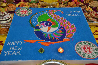 A beautiful rangoli design made by disciples was at the center of the annakut display