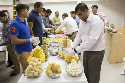 Disciples arrange various sweets prepared by disciples before offering them to Lord Shree Swaminarayanbapa Swamibapa