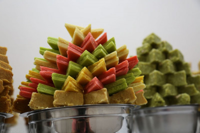 Sweets are decoratively organized as part of the New Year�s Annakut