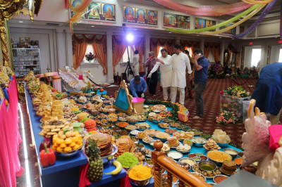Disciples make the final additions to the annakut before the Diwali and New Year celebrations commence