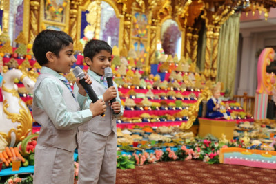 Two young disciples speak to the congregation about Diwali, �The Festival of Lights�