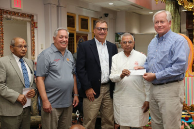 Shree Swaminarayan Temple presents MedShare with a donation to help in the Hurricane Harvey and Irma relief efforts