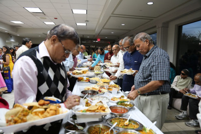 Disciples celebrate Diwali and the New Year by sharing all of the annakut prasad