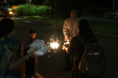Disciples finish celebrations by lighting sparkler fireworks, honoring the tradition of lighting fireworks in India for Diwali