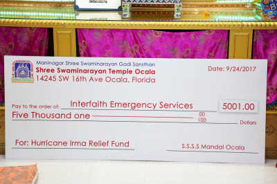A check presented to Interfaith Emergency Services for Hurricane Irma relief