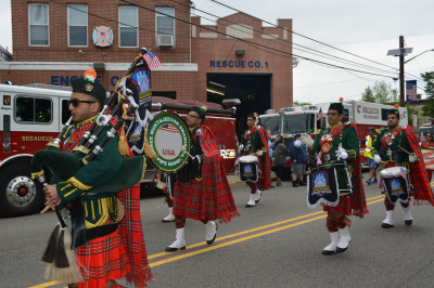 Shree Muktajeevan Swamibapa Pipe Band USA marches past the Secaucus Fire Department in the parade
