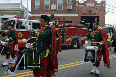 Shree Muktajeevan Swamibapa Pipe Band USA marches past the Secaucus Fire Deparment in the parade