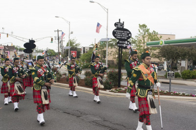 Shree Muktajeevan Swamibapa Pipe Band USA marches through the town center leading the Memorial Day parade