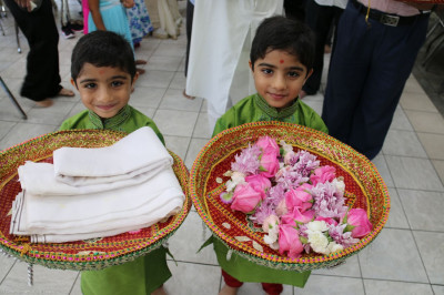 Young disciples carrying different offerings in chhaabs are eager to begin the Guru Purnima Celebrations in New Jersey