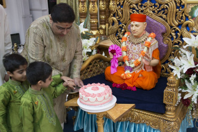 Disciples cut a cake in celebration of Guru Purnima in Shree Swaminarayan Mandir New Jersey
