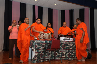 Sants sing devotional songs during the samuh raas