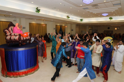 Disciples partake in the samuh raas program