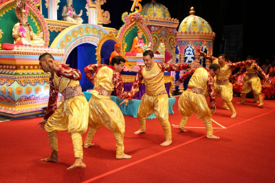Disicples perform a 75th birthday dance for Acharya Swamishree