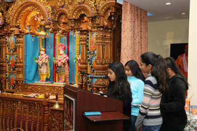 Young disciples give a speech in English and Gujarati about the New Year and the importance of our daily pooja to please Lord Shree Swaminarayanbapa Swamibapa
