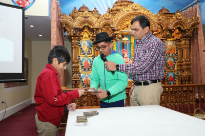 A young disciple performs magic tricks to entertain the crowd and to please Lord Shree Swaminarayanbapa Swamibapa
