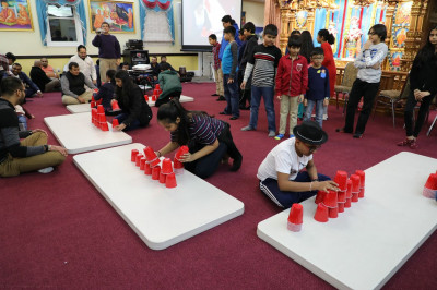 "Disciples compete in a game called  ""Cup Stack Attack "" where they see who can assemble and disassemble a pyramid of twenty-one cups in the fastest time"